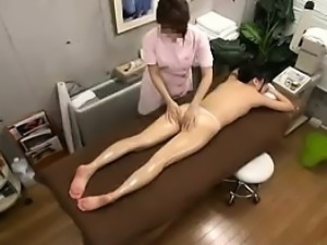 Hot girl with a heavenly ass has a masseuse caressing her l