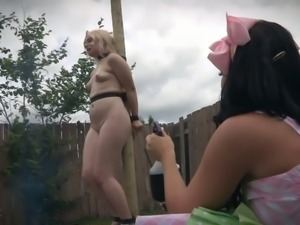 Tied up blonde Dresden gets her pussy punished in the garden