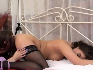 Chick pees on tied friend and dildos her cunt