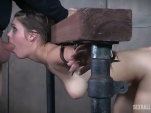Crucified and tied up bitch Nora Riley is fucked by mistress and master