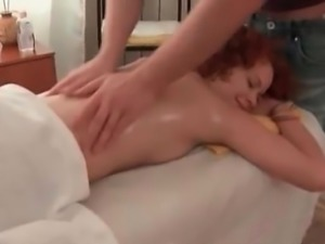 Happy hairy redhead lets masseur to play