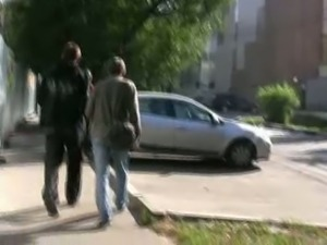 Russian brunette chick in black pants pisses on the sidewalk