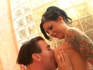 Slutty brunette bitch gives blowjob to long slim penis in bathtub