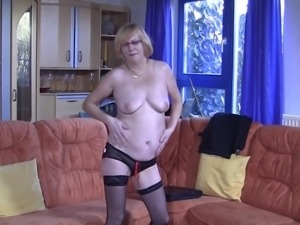 Eatable mature granny seductively showing her natural tits