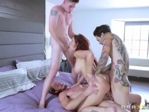 Redhead milf with fake tits in jeans loves double fucking