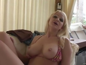 Busty babe with fake tits toy fucking her cunt on the sofa