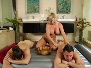 Maya poured medicated oil on guys back and used her huge melons to rub,...