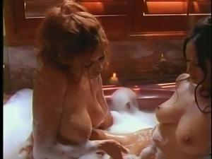 Stunning ladies have a blast with each other's bodies in a tub