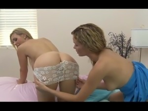 British slut Tanya on the bed in a lesbian scene again