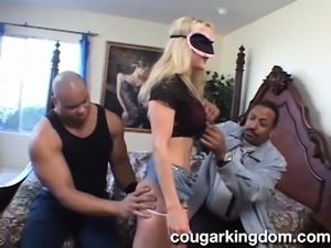 Attractive blonde wife with big hooters takes on two huge black dicks