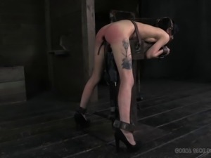 Skinny babe's pale body spanked by two horny masters