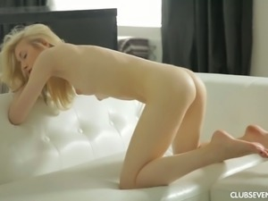 Fine lean blonde young babe undresses and plays with her pink pussy