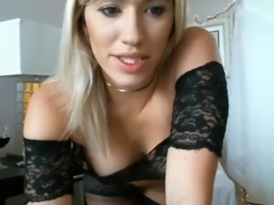 Blonde babe with huge tits in black lingerie plays on webcam