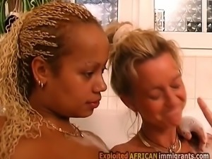 Young big boobed African babe fucks by busty blonde cougar