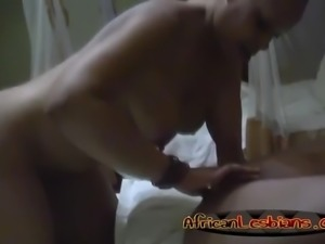 African lesbians Natasha and Maya rub their pussies in the bedroom