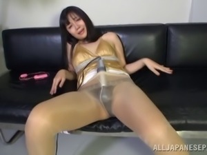 Japanese bitch wearing pantyhose uses a dildo to satisfy herself