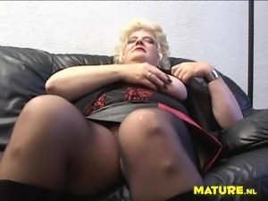 Bettanie stretching and rubbing her mature pussy that is soaking wet
