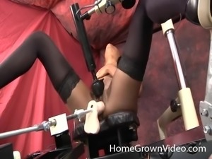Lady plays with a guy's fat cock while being fucked by a dildo
