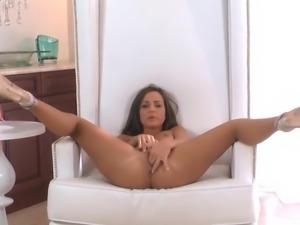 Brunette is spreading her legs wide open