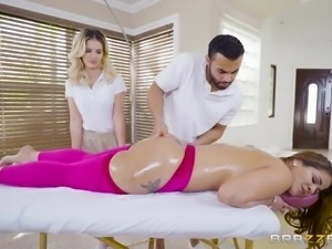 sexy babe on the massage table sucks the massuer's cock