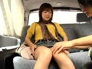 Adorable Oriental girl spreads her legs and flashes her tig