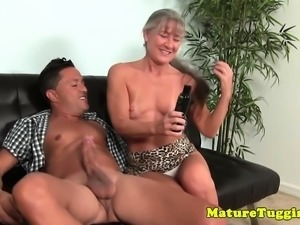Glam busty cougar jerking off hard cock