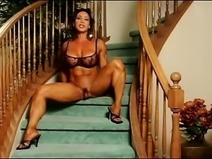 Muscle lady performs with large clit 4