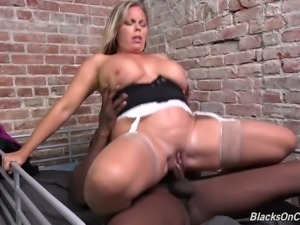 Mature blonde white lady lets a black convict grope her big breasts through...