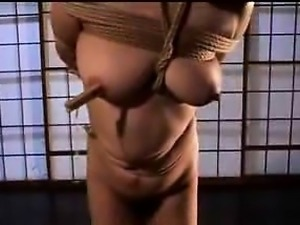 Asian gals are strung up and made to do each other, then co