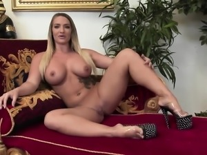 Beautiful blonde doll has her twat plugged