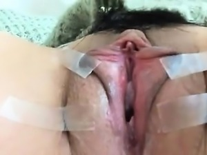 Dildo fills solo pussy in close up