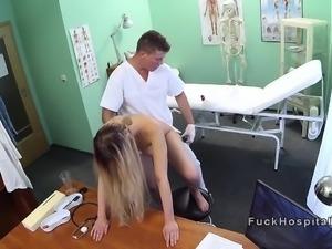Blonde sucks big cock to doctor
