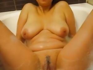 Kriss playing in bath tub
