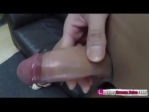 Thai Shemale Anna in stockings and heels playing with her cock