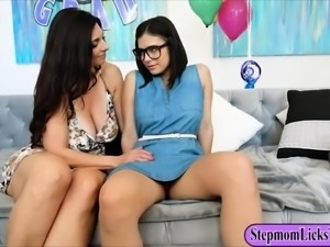 Mindi Mink and Violet Starr pleasuring each other on sofa