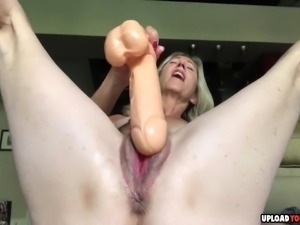 Hot MILF fucking her old pussy with a big white dildo.
