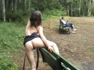 Busty auburn haired Russian beauty flashes ass and breasts in the park