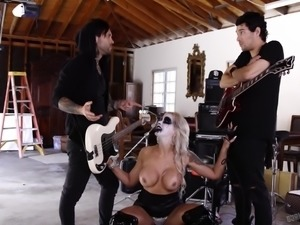 This goth babe is so turned on by the rock band, that she wants to have a...