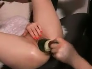 I stretch her pussy using different stuff