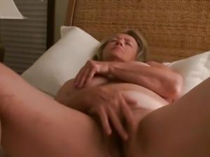 MILF masturbates to orgasm