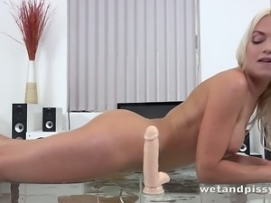 Sexy and vivacious babe Lena Love fucks her trimmed twat with her sex toy