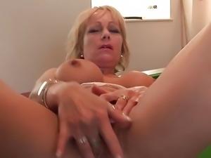 Mature British blonde masturbates