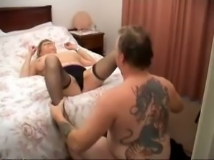 Busty old white British woman on the bed receives cunnilingus