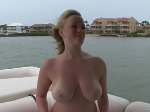 Sexy slut with big tits spreads pussy lips on the yatch