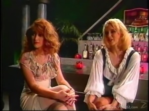 Two fair-haired lesbians share a double dildo in retro sex video