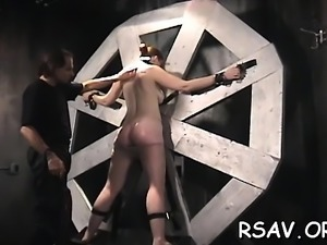 Fastened whore gets spanked hard