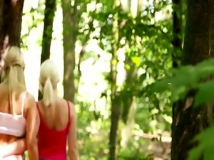 Hot blonde lesbians making love in woods