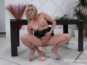 Crazy whore Brittany Bardot is riding her extremely large dildo with love