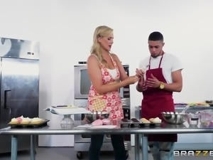 Mature Julia Ann bends over for a black man's dick in a kitchen