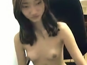 Skinny Asian girl flashing perky small tits on webcam session
